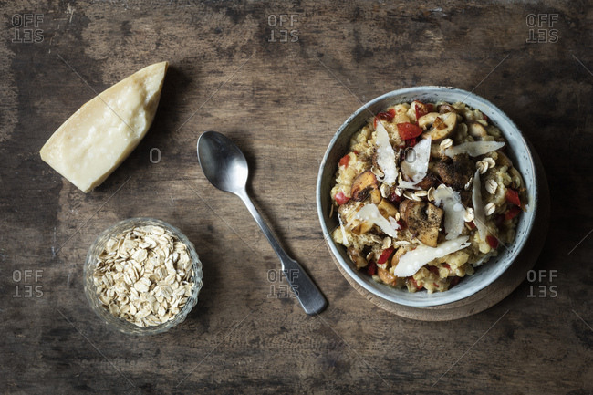 Bowl of porridge with bell pepper- champignon and parmesan