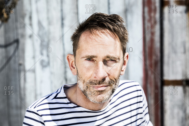 Portrait of man in striped shirt outdoors
