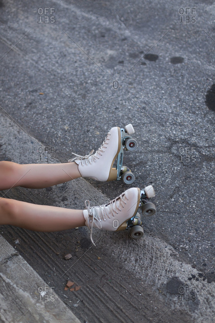 Young woman with roller skates on lane- partial view