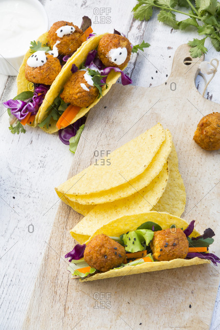 Tacos with mixed salad- sweet potato Falafel- carrot- red cabbage- yoghurt sauce- parsley and black sesame
