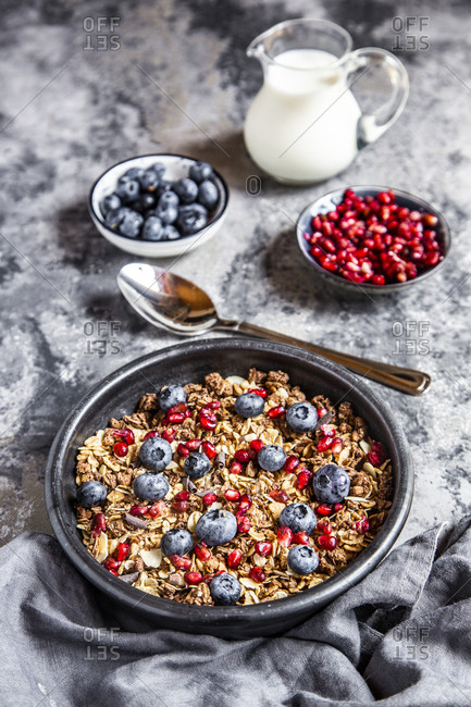 Bowl of muesli with blueberries and pomegranate seed