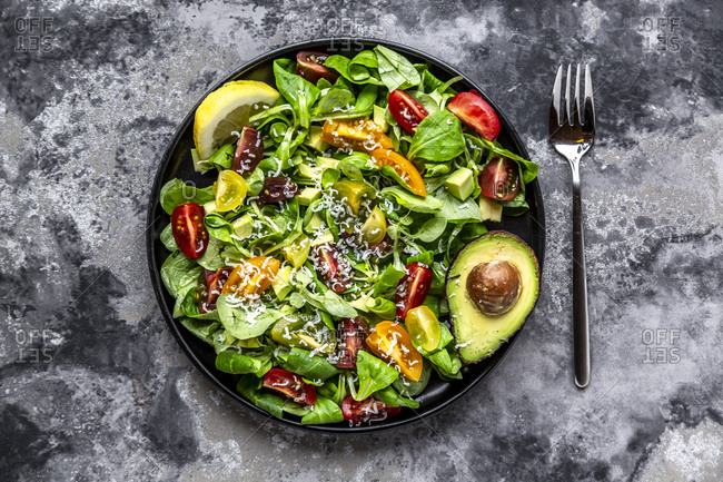 Salad with lamb's lettuce- tomatoes- avocado- parmesan and curcuma lemon dressing