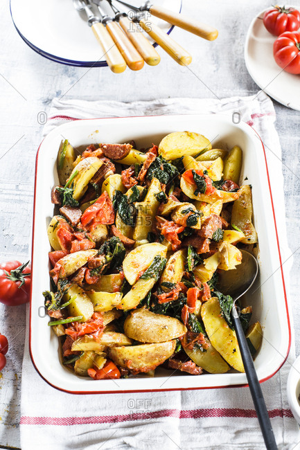 Casserole with potatoes- spinach- tomatoes and chorizzo
