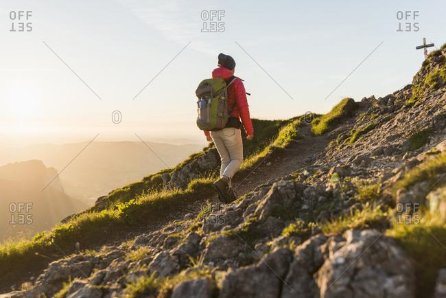 Austria- Salzkammergut- Hiker walking alone in the mountains