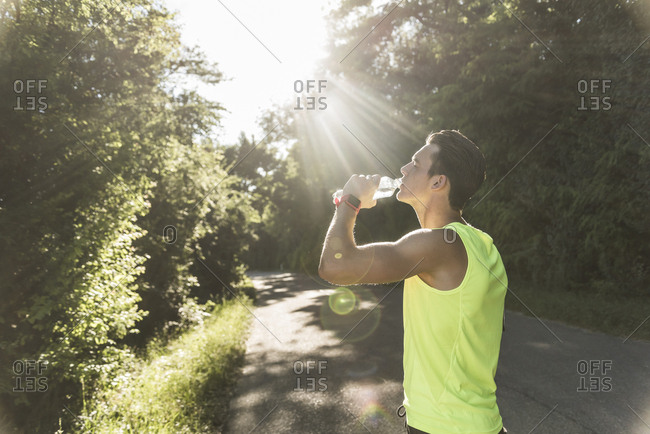 Jogger in the park drinking water