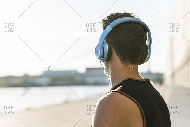 Young man with headphones looking at distance