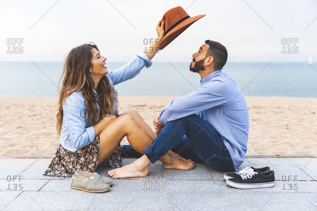Spain- Barcelona- couple having fun together on the beach