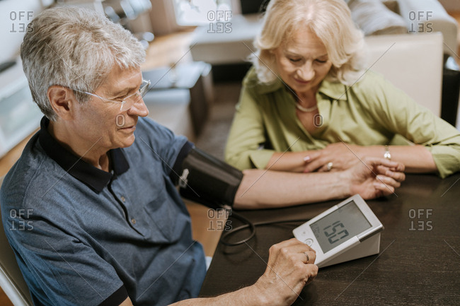 Senior couple taking blood pressure