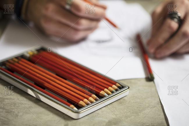 close up of artist drawing a sketch stock photo offset