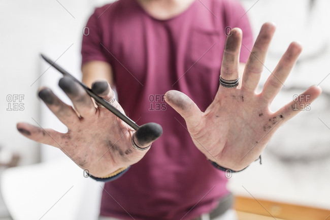 Artist showing his dirty hands