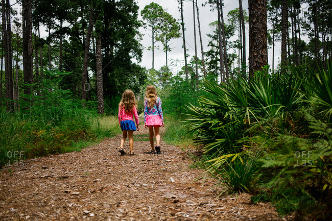 Two girls walking together on hiking trail