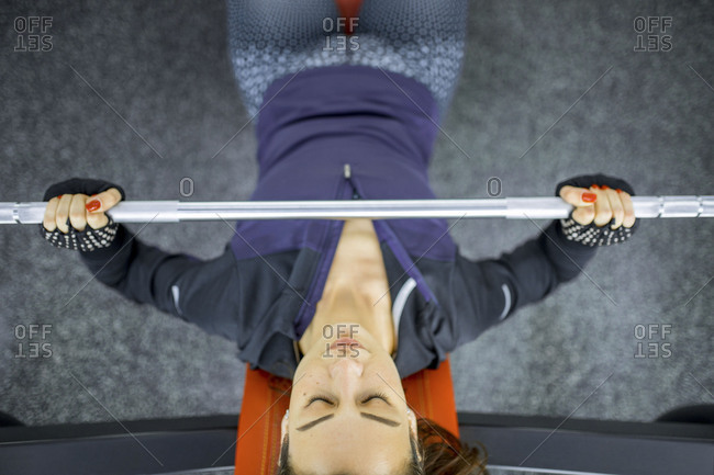 Overhead view of woman lifting weights in a gym