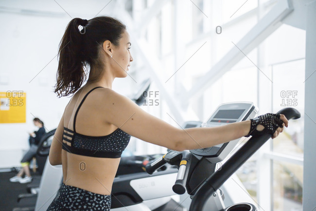 Young woman using equipment in a gym