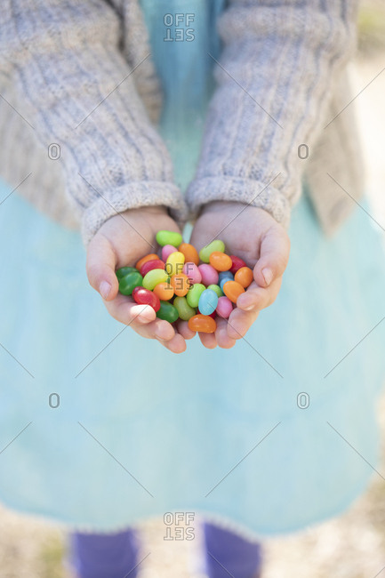 Child holding jellybeans - Offset Collection