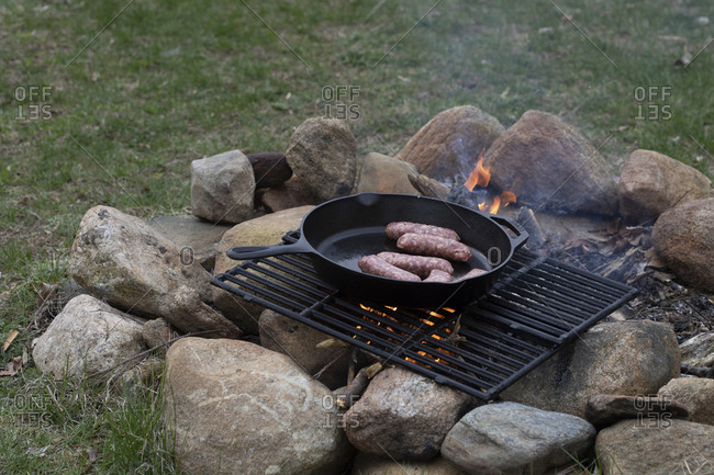Sausage on a campfire grill