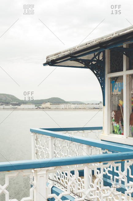 Llandudno, North Wales, UK - May 25, 2018: Llandudno Pier and city in the background on a cloudy day