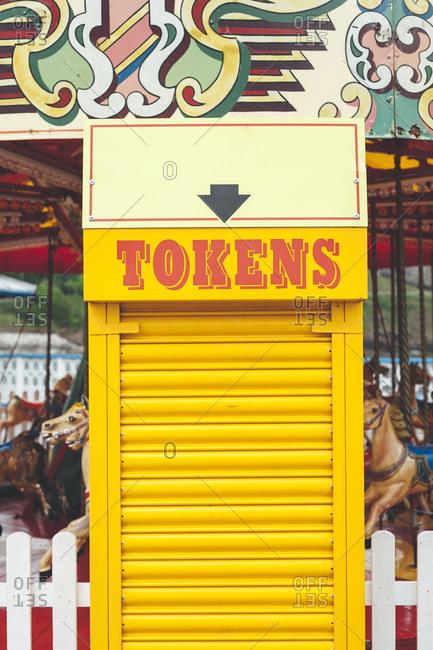Llandudno, North Wales, UK - May 25, 2018: Token booth for the carousel at Llandudno Pier
