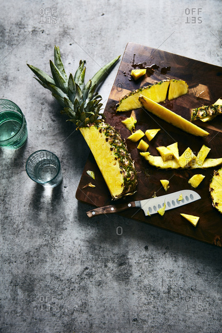 Chopped pineapples on a cutting board