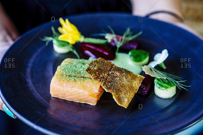 Salmon with smoked beets, cucumber, dill and zucchini blossom