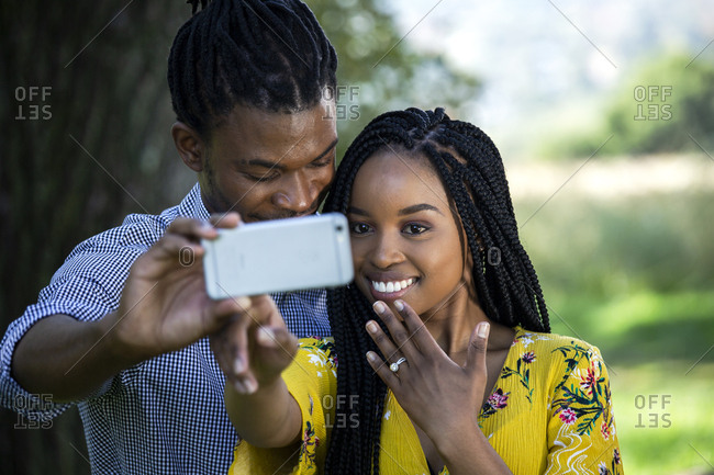 Couple taking a selfie with engagement ring