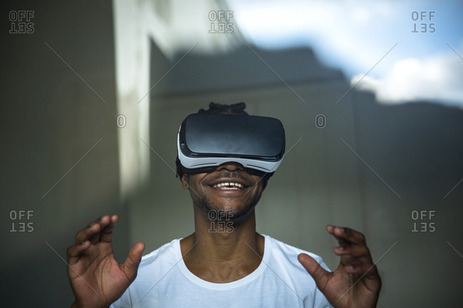 African man looking through VR headset
