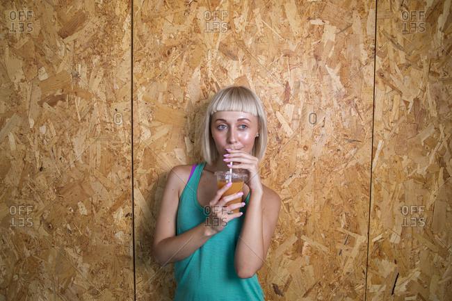 Caucasian woman drinking fruit juice