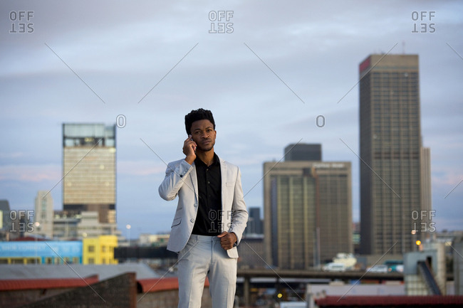 Business man listening on a phone call