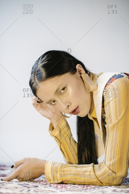 Close up of a woman wearing striped yellow blouse