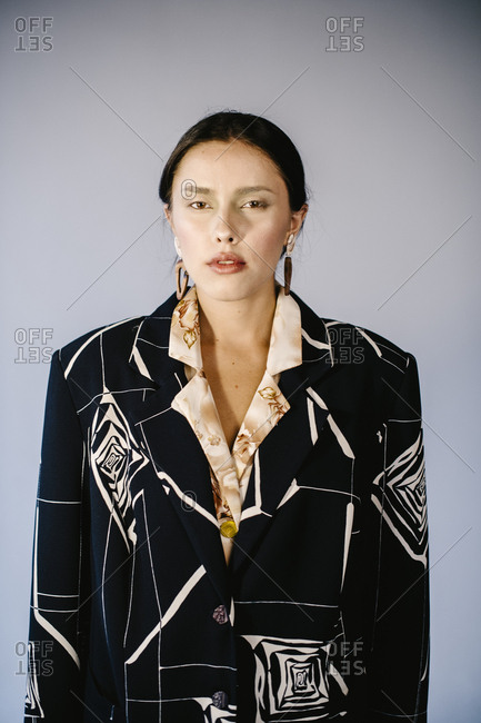 Portrait of a woman wearing black and white blazer