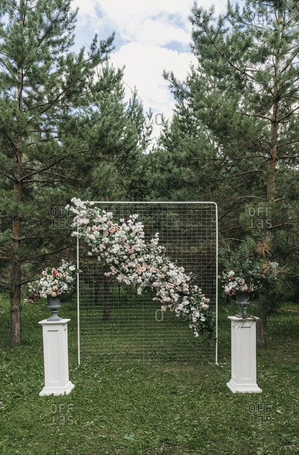 Floral backdrop at an outdoor wedding ceremony
