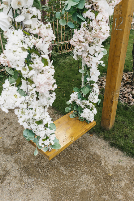 Floral swing at a wedding ceremony