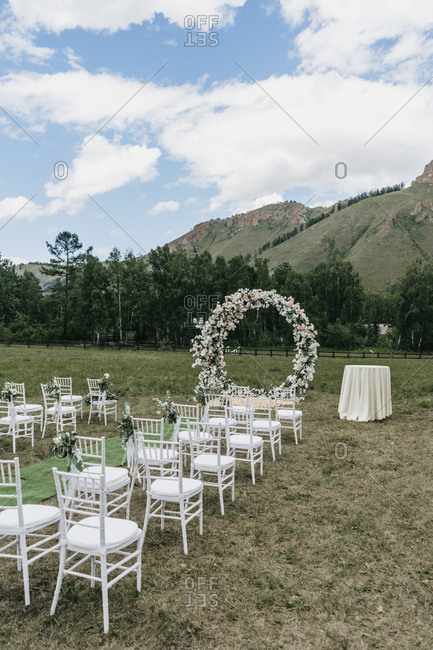 Mountainside wedding ceremony with floral ring alter
