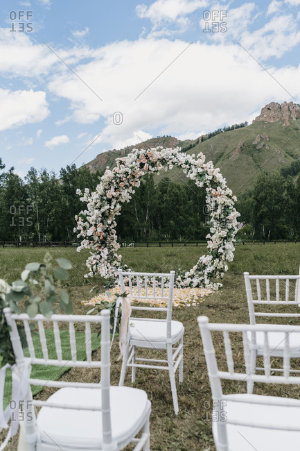 Round floral alter at a mountainside wedding ceremony