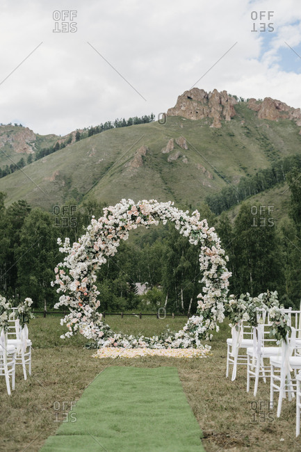 Mountainside wedding ceremony with round floral alter