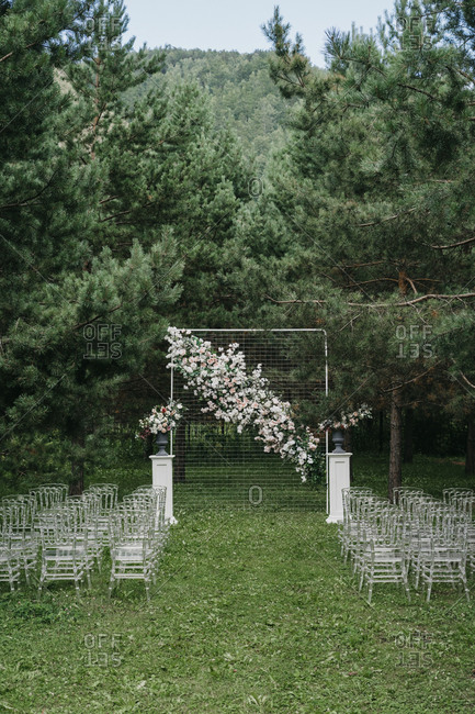 Floral alter and seats at an outdoor wedding ceremony