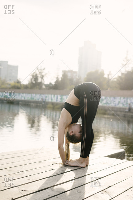 Woman doing forward bend stretch