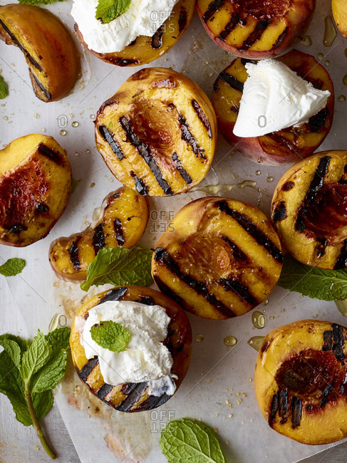 Grilled peaches served with cream