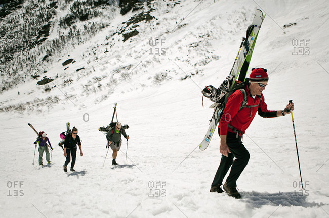 April 16, 2015: Group of skiers ascending snowy mountain, New Hampshire, USA
