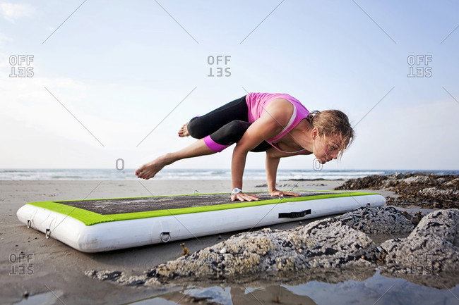 July 7, 2015: A woman does yoga on a beach