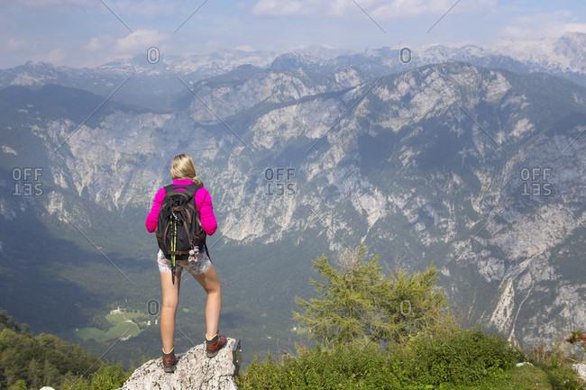 September 4, 2016: Girl enjoying view over Julian Alps from mount Vogel, Slovenia