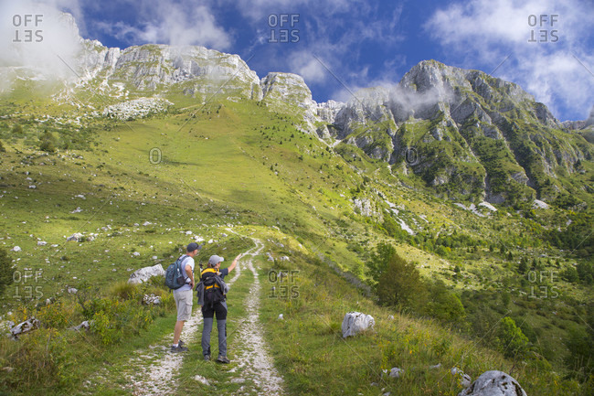 September 5, 2016: Two hikers on their way to Krn mountain in Julian Alps of Slovenia