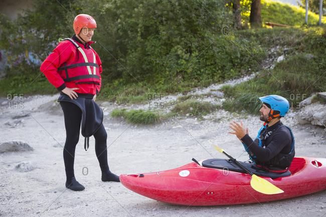 September 7, 2016: Kayak guide explaining safety procedures to tourist, Soca River near Bovec, Slovene Littoral, Slovenia
