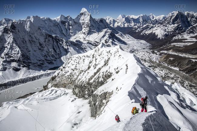 November 4, 2013: Mountain climbers descending from Island Peak, Khumbu Valley, Nepal