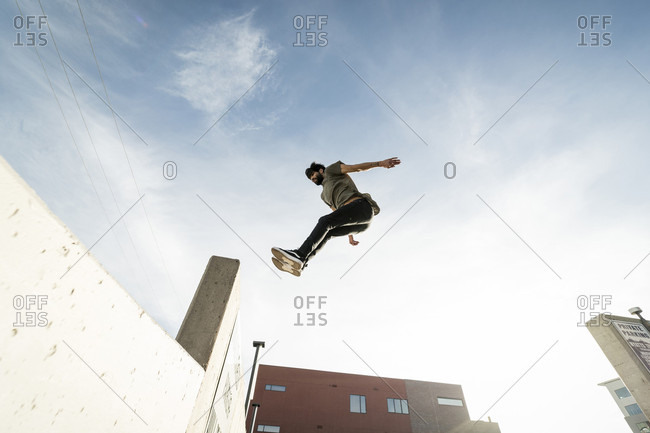 January 8, 2017: Park athlete jumping into ledge in downtown Denver, Colorado, USA