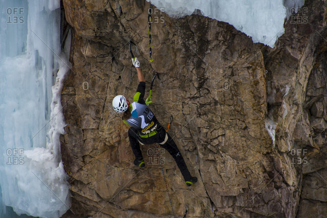 January 20, 2018: Climber ascending rock wall in Ouray Ice Park, Colorado, USA