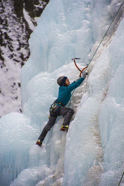 January 20, 2018: Climber ascending ice wall in Ouray Ice Park, Colorado, USA