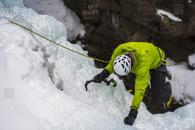January 20, 2018: Ice climber ascending wall, Colorado, USA