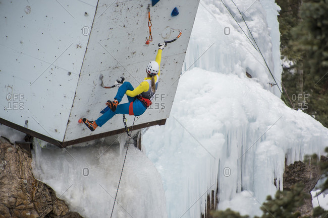 January 20, 2018: Female climber ascending climbing wall, Colorado, USA