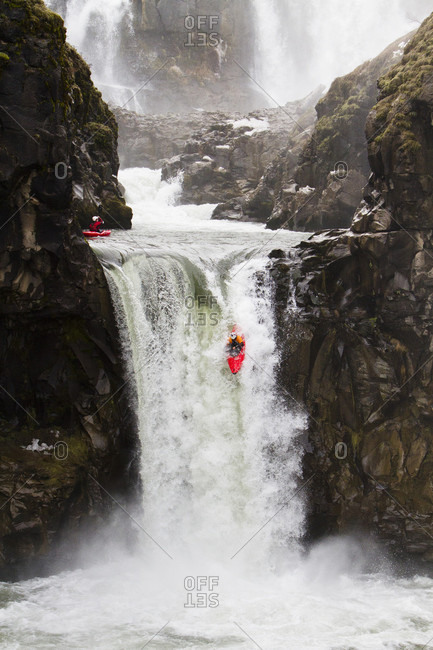 February 3, 2013: Whitewater kayaker dropping down Celestial Falls on White River, Oregon, USA
