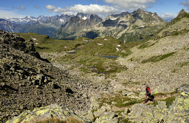 July 15, 2017: High angle view of person walking on hills during daytime, Alpe Devero, Verbania, Italy